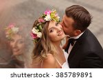 groom kissing his bride in the... | Shutterstock . vector #385789891