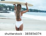 beautiful girl on a surf board... | Shutterstock . vector #385856074