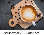 heart in the coffee cup on the... | Shutterstock . vector #385867225