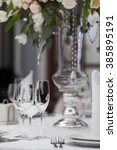 table setting at a luxury... | Shutterstock . vector #385895191