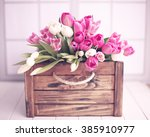 pink tulips over white wood... | Shutterstock . vector #385910977