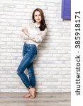 beautiful girl in a white shirt ... | Shutterstock . vector #385918171