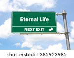 green overhead road sign with... | Shutterstock . vector #385923985