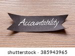 Small photo of Accountability word written on Black papper with wooden background