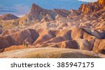 Small photo of hikers standing in front of beautiful inspiring landscape - death valley national park