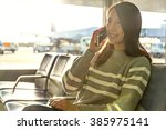 woman talk to mobile phone at... | Shutterstock . vector #385975141