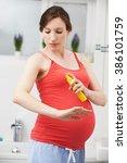 Pregnant Woman Spraying...
