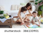 young mother  read a book to... | Shutterstock . vector #386133901