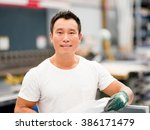asian worker in production... | Shutterstock . vector #386171479