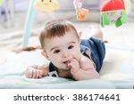 beautiful newborn baby girl... | Shutterstock . vector #386174641