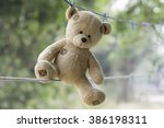 Stock photo teddy bear was tucked on a clothes line 386198311