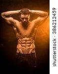 strong man posing in studio | Shutterstock . vector #386212459
