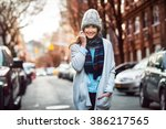 beautiful smiling woman walking ... | Shutterstock . vector #386217565