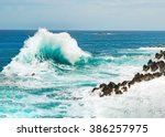 ocean wave background breaking... | Shutterstock . vector #386257975