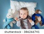ill boy lying in bed | Shutterstock . vector #386266741