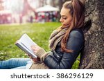 Young Woman Reading Book....