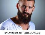 portrait of handsome man... | Shutterstock . vector #386309131