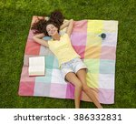 Smiling Young Woman Lying On...