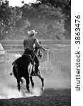 cowboy with lasso on horse at a rodeo, converted with added grain