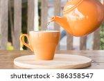 hot tea is poured from teapot...   Shutterstock . vector #386358547