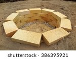 Small photo of Step by step making of a fire pit using yellow aluminous bricks in the garden