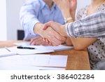business people handshaking... | Shutterstock . vector #386402284