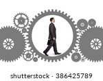 businessman walking inside gear | Shutterstock . vector #386425789