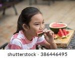young girl enjoying a delicious ... | Shutterstock . vector #386446495