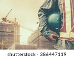 construction worker checking... | Shutterstock . vector #386447119