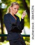 young business woman smoking... | Shutterstock . vector #38645296
