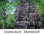 ancient stone faces of bayon... | Shutterstock . vector #386460169