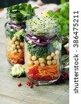 healthy homemade mason jar... | Shutterstock . vector #386475211