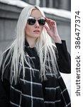 portrait of young blonde model... | Shutterstock . vector #386477374