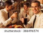 three young businessmen in... | Shutterstock . vector #386496574