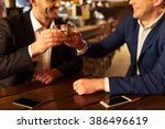 two young businessmen are... | Shutterstock . vector #386496619