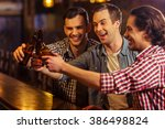three young men in casual... | Shutterstock . vector #386498824