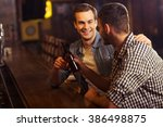 two young men in casual clothes ... | Shutterstock . vector #386498875