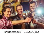 three young men in casual... | Shutterstock . vector #386500165