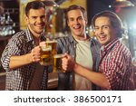 three young men in casual... | Shutterstock . vector #386500171