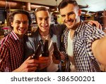 three young men in casual... | Shutterstock . vector #386500201