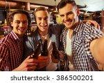 three young men in casual... | Shutterstock . vector #386500201
