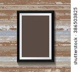 black frame on old wood texture ... | Shutterstock .eps vector #386503825