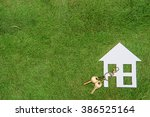 paper house and key  home... | Shutterstock . vector #386525164