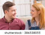 smiling young woman with her... | Shutterstock . vector #386538055