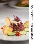 Small photo of Tuna tartare Ahi tuna, avocado mousse, aioli and crostini