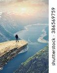 woman on trolltunga    view on... | Shutterstock . vector #386569759