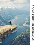 woman on trolltunga    view on... | Shutterstock . vector #386569771