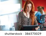 confident female designer... | Shutterstock . vector #386570029