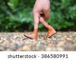 hand finger walking in garden... | Shutterstock . vector #386580991