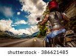 biker girl rides a motorcycle... | Shutterstock . vector #386621485
